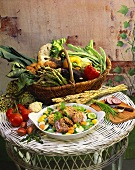 Buckwheat rissoles on vegetables; vegetable basket on table