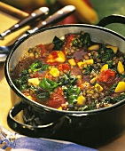 Lentils with vegetables in a cooking pot