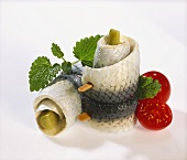 Rollmops with mint leaves and cherry tomatoes