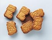 Shaped chocolate biscuits (Spekulatius) on light grey base