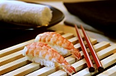 Shrimp Sushi with Red Chopsticks