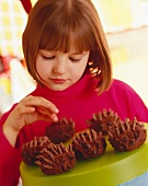 Child with Chocolate Desserts shaped like Porcupines