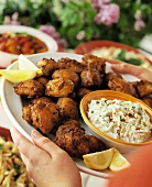 Pieces of Spicy Chicken with Coleslaw on Serving Platter