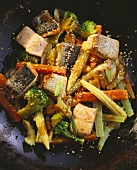 Salmon with Vegetables and Sesame Seeds in a Pan