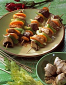 Meat and vegetable kebabs with sesame