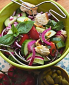 Vegetable salad with cucumber, pine nuts and white bread