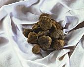 Black truffles on a white cloth