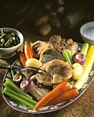 Pot au feu with meat, chicken, marrow bone and vegetables