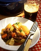 Beef ragout with vegetables in beer sauce