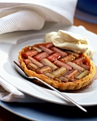 Rhubarb tartlet with cream on plate