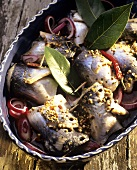 Rollmops with onions and spices
