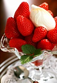 Fresh Strawberries with Cream in Glass Dish