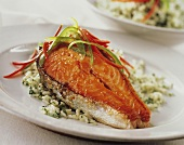 Glazed salmon cutlet with strips of pepper on herb rice