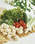 Vegetables, salad and mushrooms on straw mat