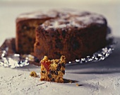 Fruit cake on foil and a small piece of cake in front