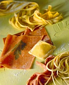 Still life with home-made partly coloured pasta