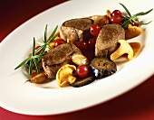 Venison fillets with chanterelles, cranberries & rosemary