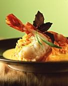 Fried jumbo prawns on pumpkin casserole