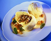 Waldviertel dumpling, filled with lardons, on plate