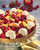 Colourful fruit tart with cream rosettes & lemon balm leaves