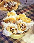 Crepes with chanterelles in parchment in a dish