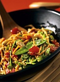 Mixed vegetables with mangetouts and sesame in wok