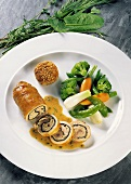 Rabbit roulade with mustard sauce and vegetables
