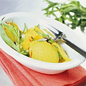 Kohlrabi with saffron and fresh tarragon in deep plate
