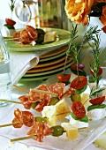 Cheese and salami and mozzarella and tomato kebabs