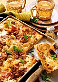 Bacon pizza with mince and onions on baking tray