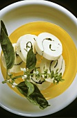 Butter roulade with basil on a plate