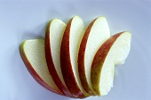 A few apple slices, arranged in a fan