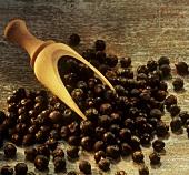 Juniper berries on small wooden scoop