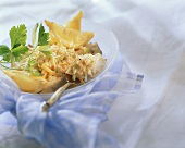 Halibut with rice and vegetable crust, lemons and parsley
