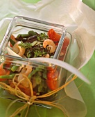 Bean and shrimp salad with seaweed and thyme in a glass