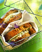 Goat's cheese sandwich with cucumber & borage in wire basket