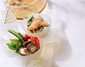 Fondue chinoise with raw vegetables & salmon in bowls