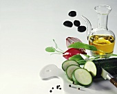 Olive oil in jug, courgettes, sage, onions & olives