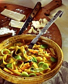 Cut noodle soup with chicken and leek in a soup tureen