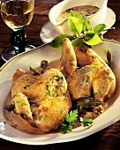 Braised chicken with bay leaf on platter; Sauce; White wine