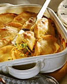 Oven-baked potato dish (Stritzels) with vegetable filling