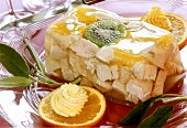 Chicken in aspic with oranges, kiwi fruit and sage