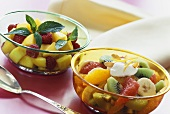 Peach salad with raspberries; fruit salad with flaked almonds