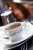 A cup of coffee on a table at the Café de Flore, Paris