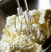 Making creamed cake mixture:creaming butter with hand mixer