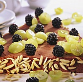 Triangle cake with grapes and blackberries