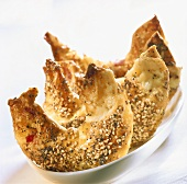 Quark pastry croissants with poppy seeds and sesame