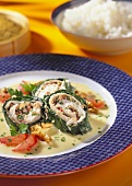 Plaice rolls wrapped in spinach with walnut kernels