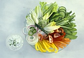 Plate of raw vegetables and herb quark dip