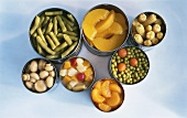 Opened fruit and vegetable tins